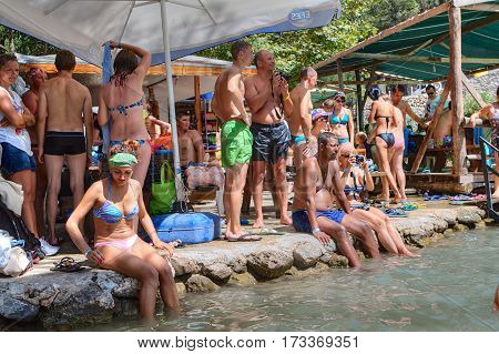 Kemer Antalya Turkey - august 26 2014: A large group of tourists saved from the heat near a mountain stream in a canyon Kuzdere while on the Taurus mountains tours.