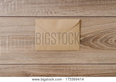 Blank postcard and envelope on old wooden background