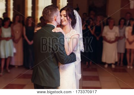 Romantic Newlywed Couple Hugging, Handsome Groom And Beautiful Happy Bride First Dance While Holding