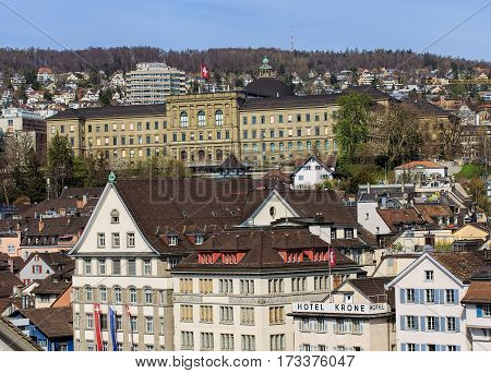 Zurich, Switzerland - 13 April, 2015: old town of the city in springtime, building of the Swiss Federal Institute of Technology in Zurich, decorated with flag of Switzerland. Zurich is the largest city in Switzerland.