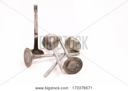 Used Distorted Car Valves Over White Background