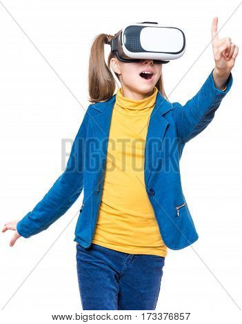 Happy amazed little girl wearing virtual reality goggles watching movies or playing video games, isolated on white background. Cheerful surprised child looking in VR glasses and gesturing with his hands.