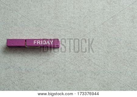 Friday written on a cloth peg isolated on a white background