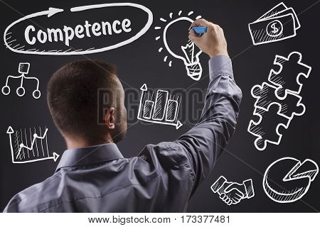 Technology, Internet, Business And Marketing. Young Business Man Writing Word: Competence