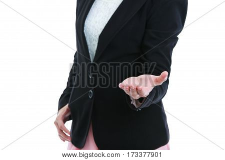 Closeup of woman showing hand up empty copy space on open hand palm for display product or text. Business woman in black suit. Isolated on white background. studio shot.