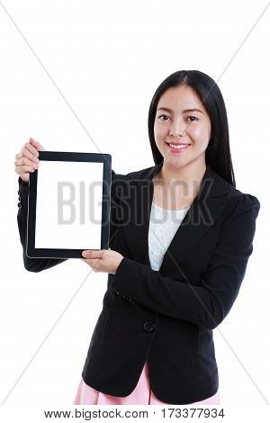 Happy asian woman holding digital tablet and looking at camera. Isolated on white background. Successful businesswoman looking confident and smiling. Positive human emotion. Studio shot.