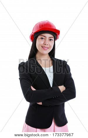 Portrait of attractive professional female contractor wearing red construction helmet. Cheerful asian businesswoman smiling. Isolated on white background. Studio shot. Positive human emotion.