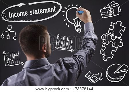 Technology, Internet, Business And Marketing. Young Business Man Writing Word: Income Statement