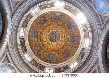 ROME, ITALY - SEPTEMBER 02: The cupola in Chigi chapel designed by Raphael, painting of the creation story by Francesco Salviati in Church of Santa Maria del Popolo, Rome, Italy on September 02, 2016.