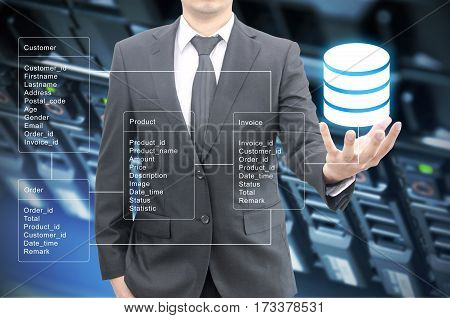 Professional Businessman Hold Database Table With Server Storage And Network In Datacenter Backgroun