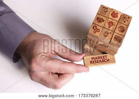 Business, Technology, Internet And Network Concept. Young Businessman Shows The Word: Market Researc