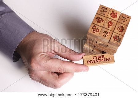 Business, Technology, Internet And Network Concept. Young Businessman Shows The Word: Cyber Investme