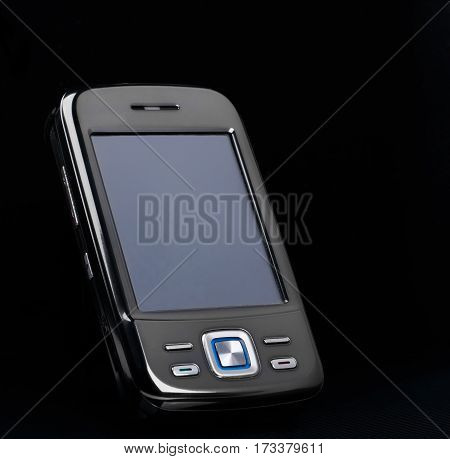 outmoded smartphone with blank screen on black background