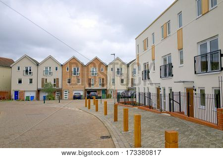 Bracknell, England - February 26, 2017: New build apartment block and town houses on a modern housing estate in Bracknell, England on a cloudy day