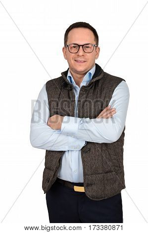 Young handsome man in white shirt and waistcoat wearing fashion glasses while posing against white background with crossed arms