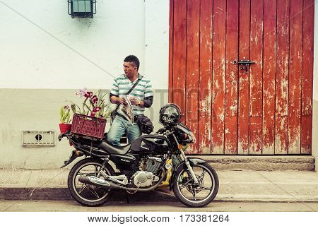 Popayan, Colombia - November, 17th, 2015 - flower sales man in white city popayan colombia south america
