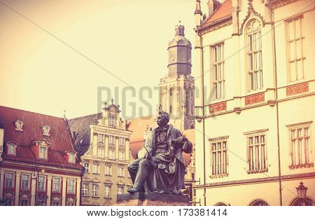 statue of the Polish poet playwright and comedy writer Aleksander Fredro in the Market Square in front of the Town Hall of Wroclaw Poland poster