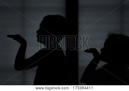 a Children dancing Egyptian dance shadow silhouette on fabric background