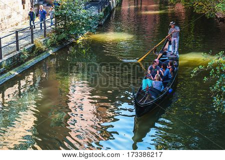 BAMBERG, GERMANY - Circa September, 2016: Gondolier rowing tourists in a gondola on a canal in Little Venice, Bamberg, Germany in a travel and tourism concept
