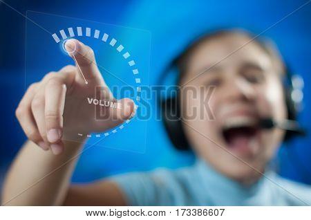 girl in headphones adds volume to maximum