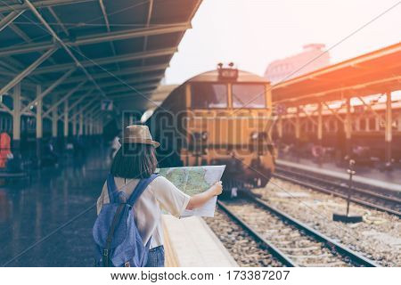 Young Woman Traveler Looking The Map In Bangkok Train Station
