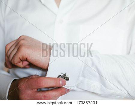 Man wears cufflinks. Fashion formal. Men. Style