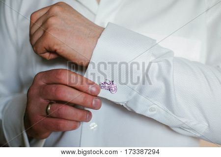 Man wears cufflinks. Fashion formal. Men. Style