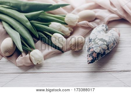 Stylish White Tulips Easter Eggs And Floral Heart On Rustic Wooden Background. Hello Spring. Happy E