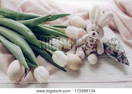 Happy Easter Concept. Greeting Card With Space For Text. Stylish White Tulips Easter Eggs And Bunny