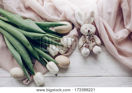 Happy Easter Flat Lay Concept. Greeting Card With Space For Text. Stylish White Tulips Easter Eggs A