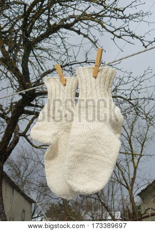Thick warm socks drying on a clothesline