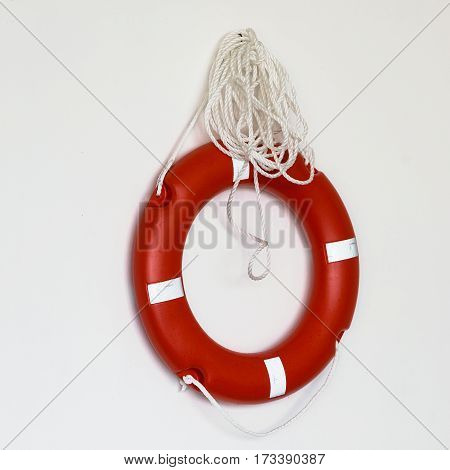 Red lifebuoy isolated over white background, close up