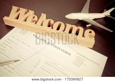 Filling travel Visa application form on arrival welcome