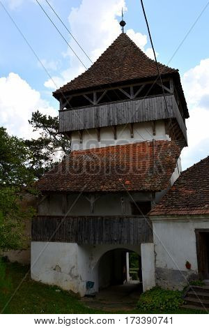 Fortified medieval saxon church in Ungra, a commune in Braşov County, Romania. Here there is a medieval 13th century Transylvanian Saxon church and many old houses