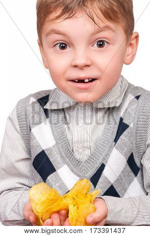 Portrait of cheerful little boy with packet of potato chips. Close-up of child eating fast food, isolated on white background.