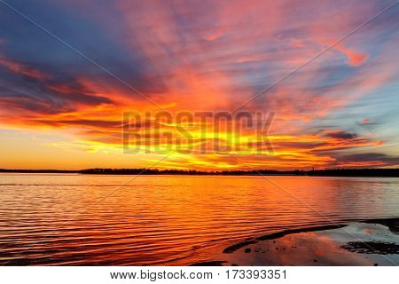 A beautiful red and yellow sunset over a lake in Oklahoma.