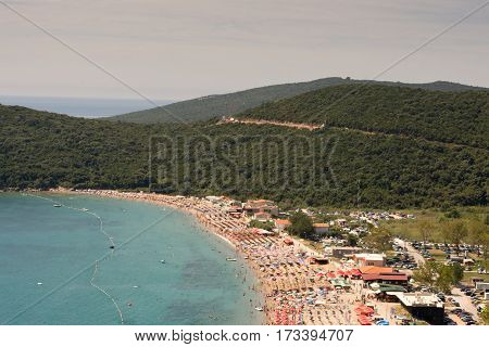 Aerial View Sunny Sea Beach With Parasols