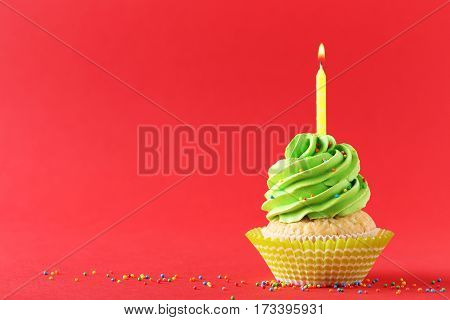 Tasty Cupcake With Candle On A Red Background