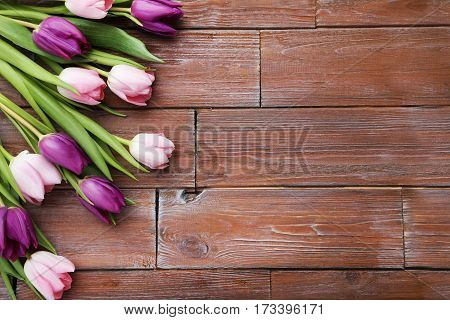 Bouquet Of Tulips On A Brown Wooden Table