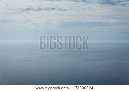 Empty Blue Sky And Blue Sea Background Copy Space