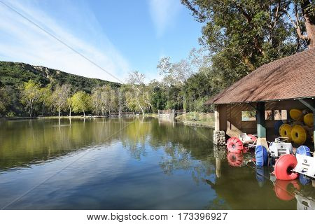 ORANGE, CALIFORNIA - FEBRUARY 24, 2017: Pond and Rental Shed at Irvine Regional Park. Founded on land donated by james Irvine, it is the oldest regional park in California.