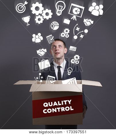Business, Technology, Internet And Network Concept. Young Businessman Shows The Word: Quality Contro
