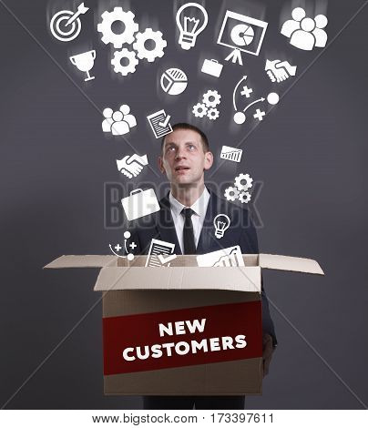 Business, Technology, Internet And Network Concept. Young Businessman Shows The Word: New Customers