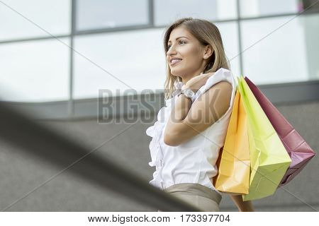 Young woman shopping in the downtown. Portrait.