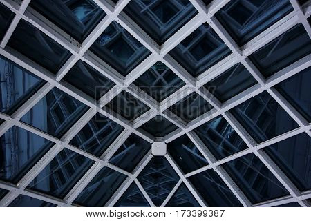 Modern glass roof at night with reflection