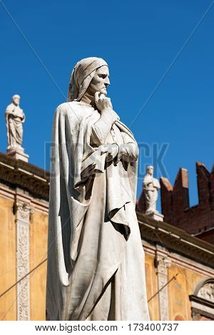 VERONA ITALY - SEPTEMBER 17 2016: Statue of Dante Alighieri (1265-1321) father of the Italian language in Piazza dei Signori in Verona (UNESCO world heritage site) Veneto Italy