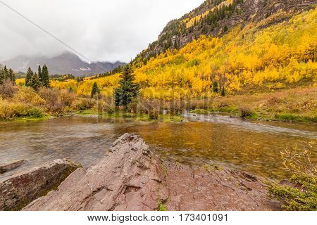 a scenic fall landscape during a storm at the maroon bells near Aspen Colorado