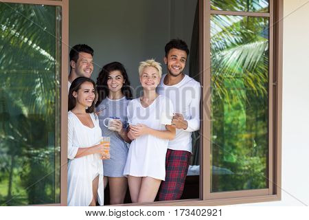 Young People Group On Terrace Tropical Hotel, Morning Friends Enjoy View Tropic Holiday Vacation Green Forest