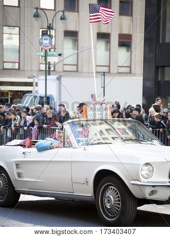 NEW YORK - NOV 11, 2016: Vets ride in a classic vintage car parade vehicle during the 2016 America's Parade on Veterans Day in New York City on November 11, 2016.