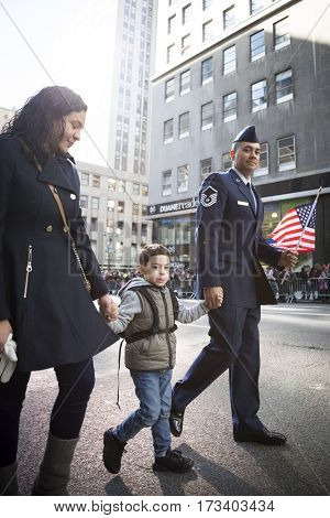 NEW YORK - 11 NOV 2016: Member of the USAF marches with his family in the annual Americas Parade produced by the United War Veterans Council UWVC on 5th Avenue on Veterans Day in Manhattan.